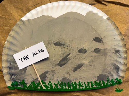 "Completed background with ""the alps"" sign."