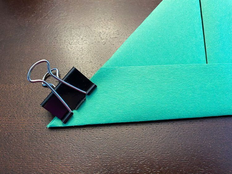 Using a binder clip to hold the corners while they glue.