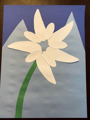 Gluing the five small white petals in between the larger petals.