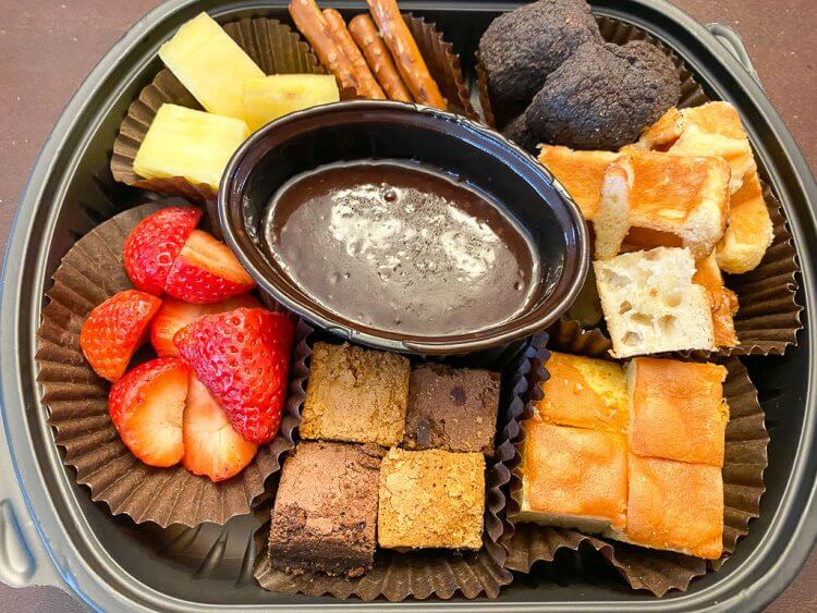 Chocolate fondue with strawberries, pineapple, pretzels, marshmallows, cake, and brownies.