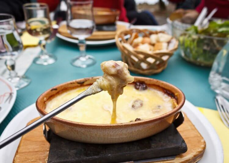 Cheese fondue with skewer.