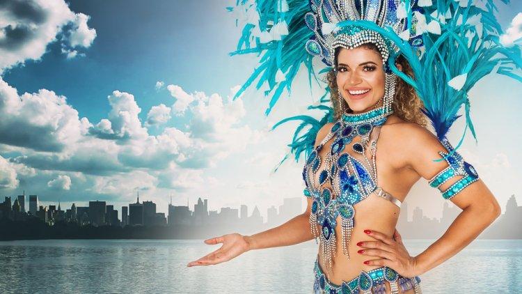 Beautiful brazilian samba dancer wearing traditional costume and New York skyline