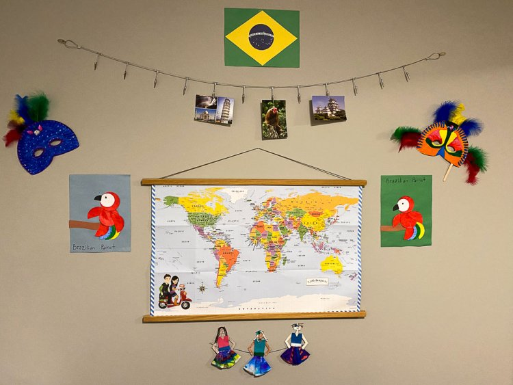Display of Brazil crafts on the wall with a large map in the center.