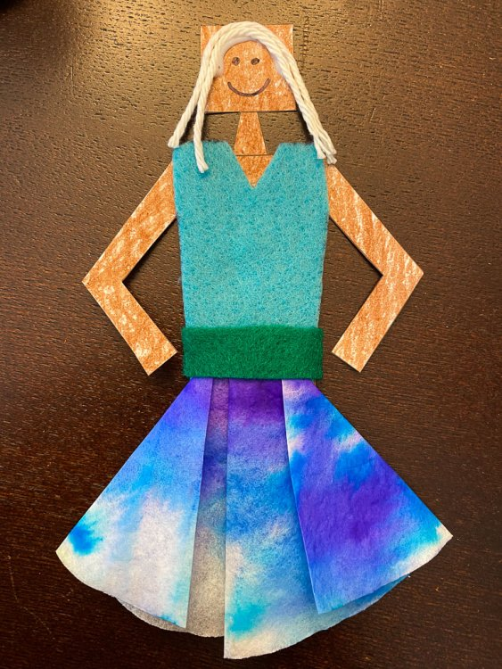 Dancer with yarn for hair, drawn on face, colored paper body, felt dress, colorful cupcake liner skirt and felt belt.