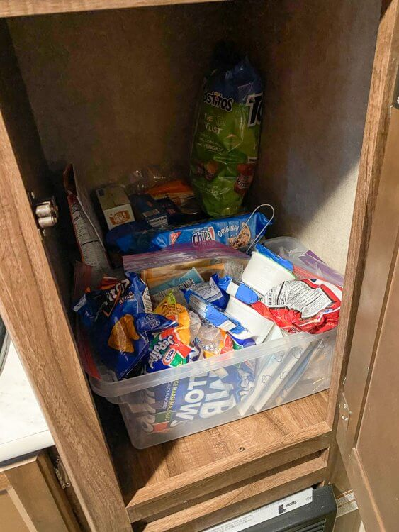 Storage bins to organize food inside the pantry cabinet