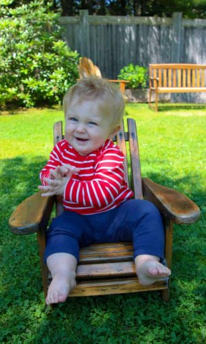 Baby sitting in a chair in thuya garden gardens acadia